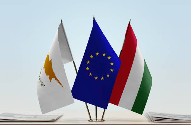 flags of cyprus european union and hungary - conferences stock photos and pictures