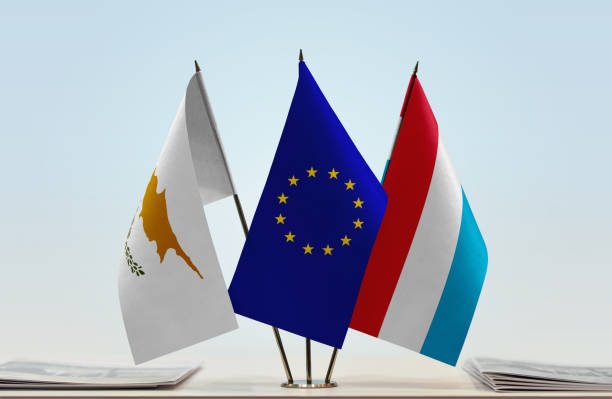 flags of cyprus european union and luxembourg - conferences stock photos and pictures