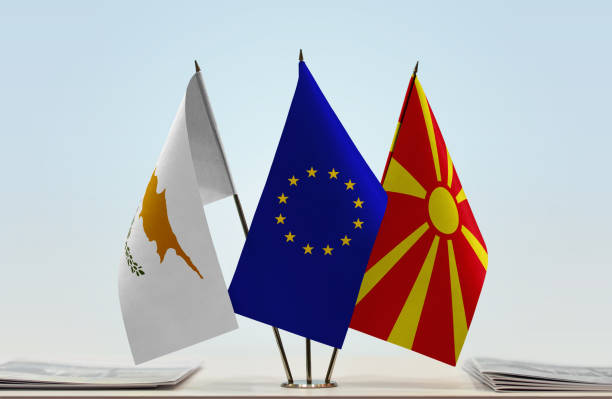 flags of cyprus european union and macedonia fyrom - conferences stock photos and pictures