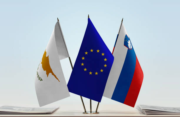flags of cyprus european union and slovenia - conferences stock photos and pictures