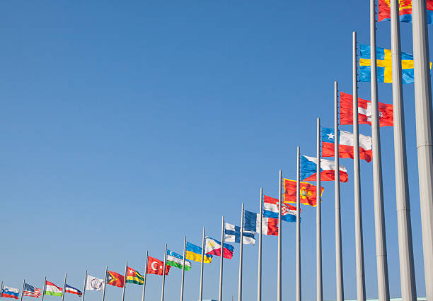 Flags of different countries on the flagpole - foto de stock