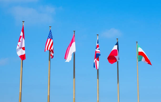 Flags of different countries on the flagpoles stock photo