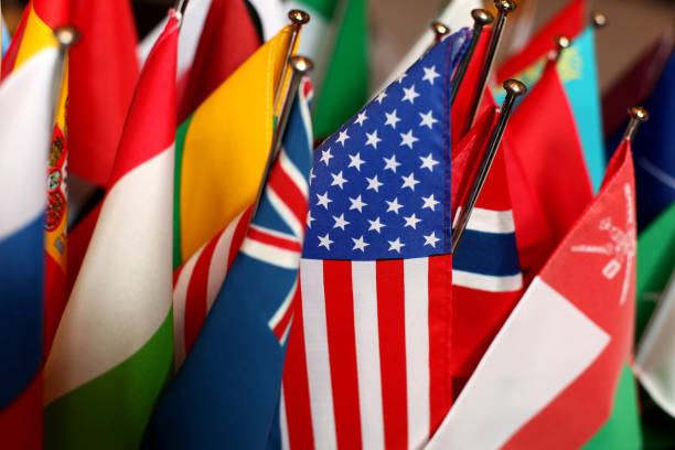 Flags of different Countries together, US-Flag in Focus Concept Picture for international Themes national flag stock pictures, royalty-free photos & images