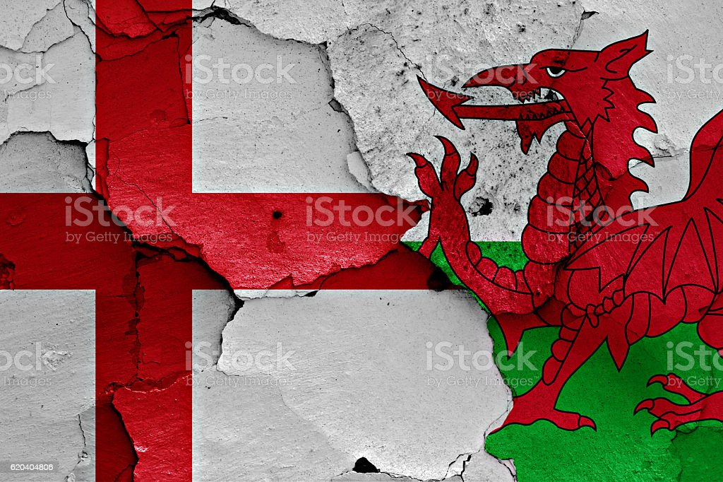 flags of England and Wales painted on cracked wall stock photo