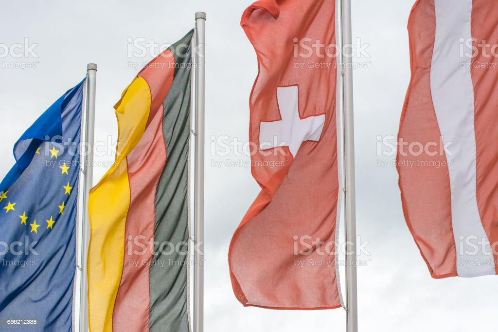 Flags of European Union, Germany, Switzerland and Austria together stock photo