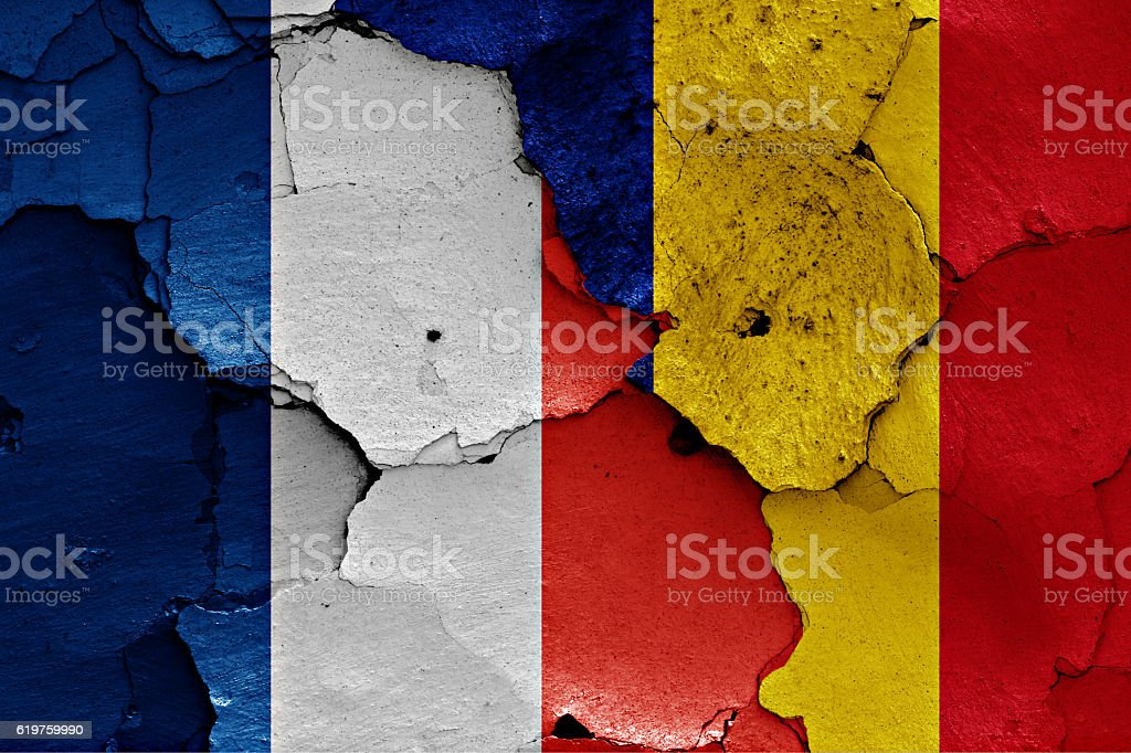 flags of France and Romania painted on cracked wall stock photo