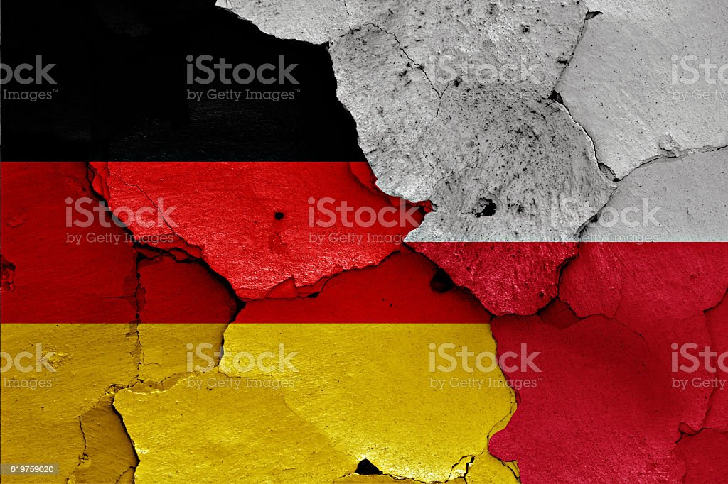 flags of Germany and Poland painted on cracked wall stock photo