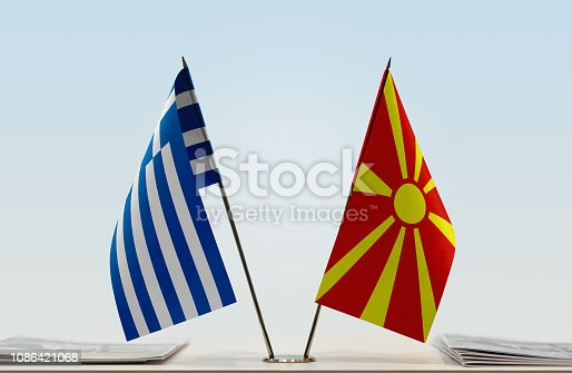 1056280906istockphoto Flags of Greece and Macedonia FYROM 1086421068