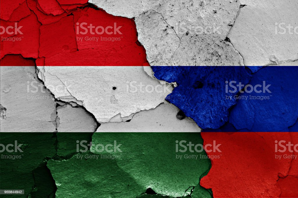 flags of Hungary and Russia painted on cracked wall stock photo