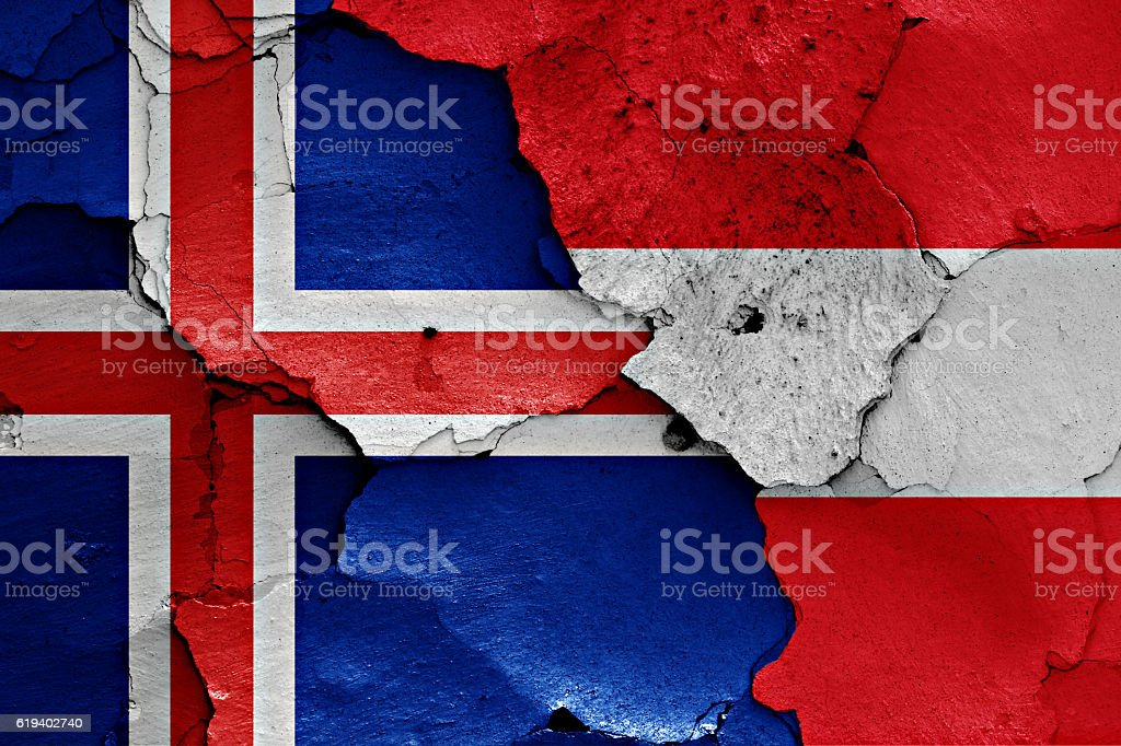 flags of Iceland and Austria painted on cracked wall stock photo