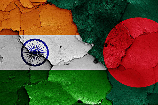 flags of India and Bangladesh painted on cracked wall stock photo