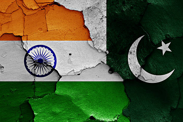 flags of india and pakistan painted on cracked wall - pakistano foto e immagini stock
