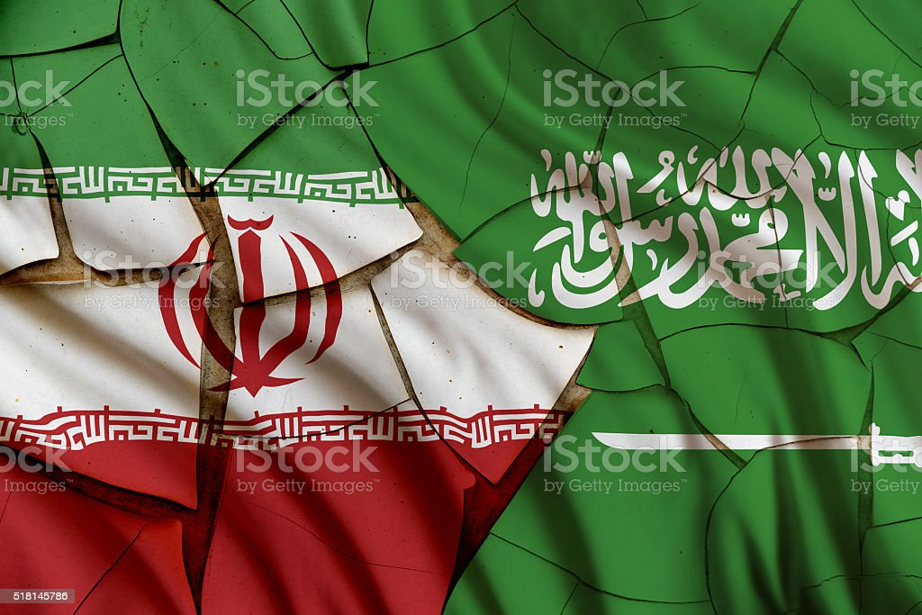 Flags of Iran and Saudi Arabia on a cracked wall. stock photo
