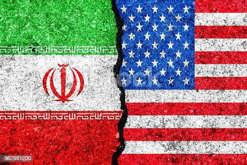 Flags of Iran and USA painted on cracked wall background/Iran versus USA conflict concept