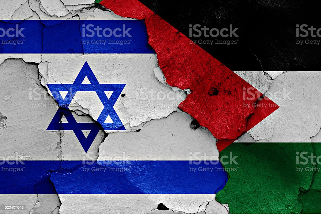 flags of Israel and Palestine painted on cracked wall stock photo