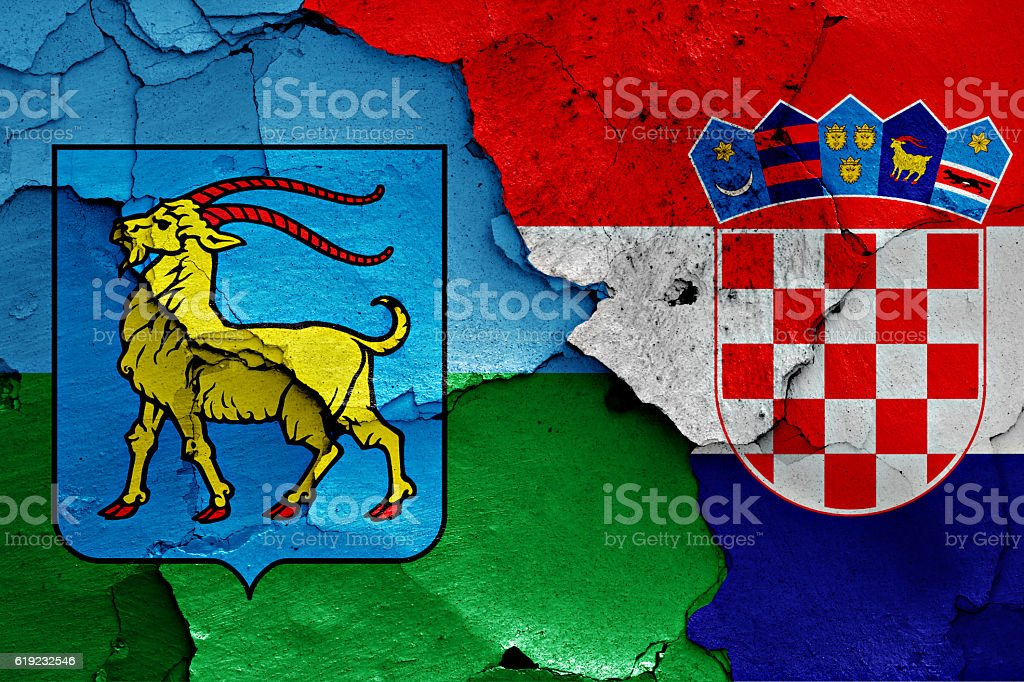 flags of Istria County and Croatia painted on cracked wall stock photo