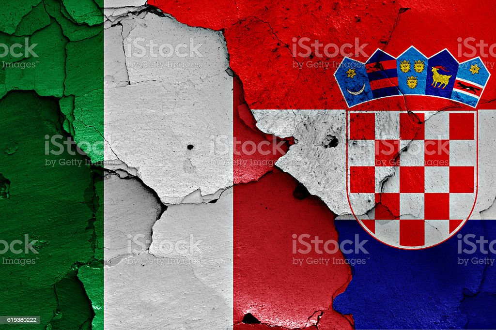 flags of Italy and Croatia painted on cracked wall stock photo