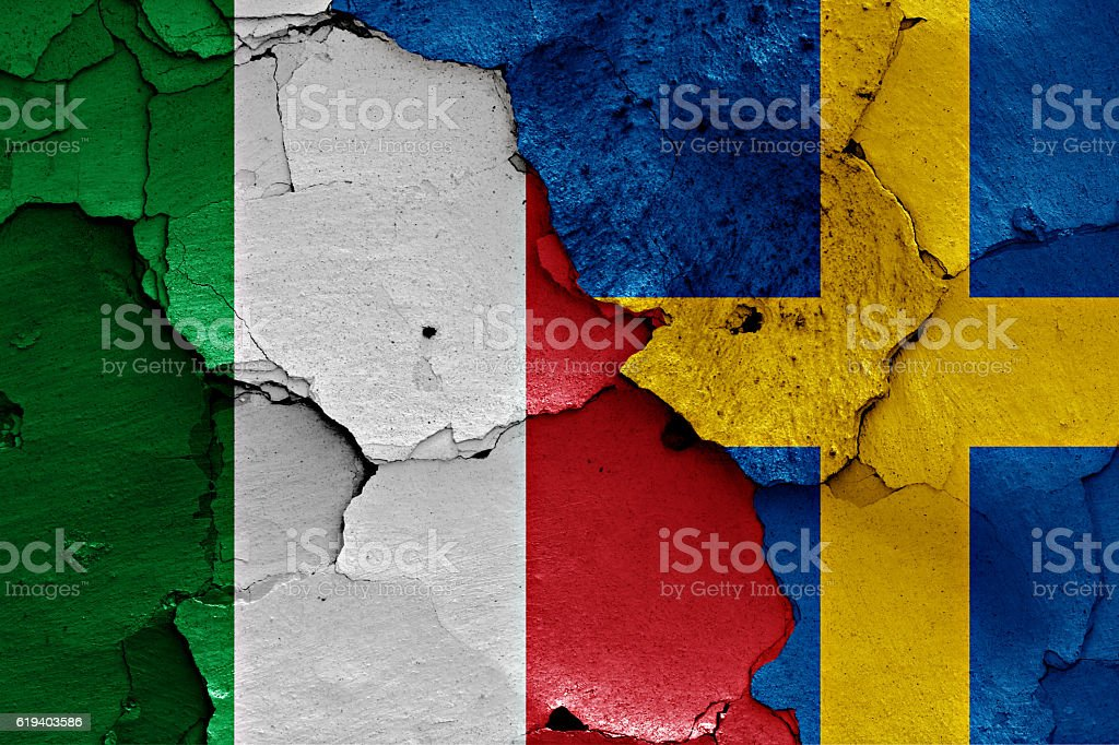 flags of Italy and Sweden painted on cracked wall stock photo