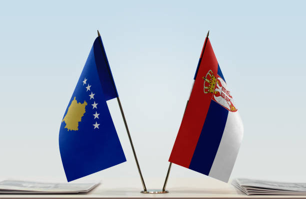 Flags of Kosovo and Two table flags of Kosovo and serbia stock pictures, royalty-free photos & images