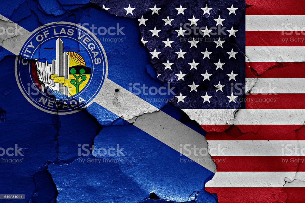 flags of Las Vegas and USA painted on cracked wall stock photo