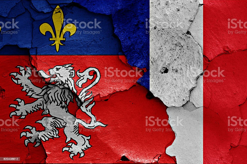 flags of Lyon and France painted on cracked wall stock photo