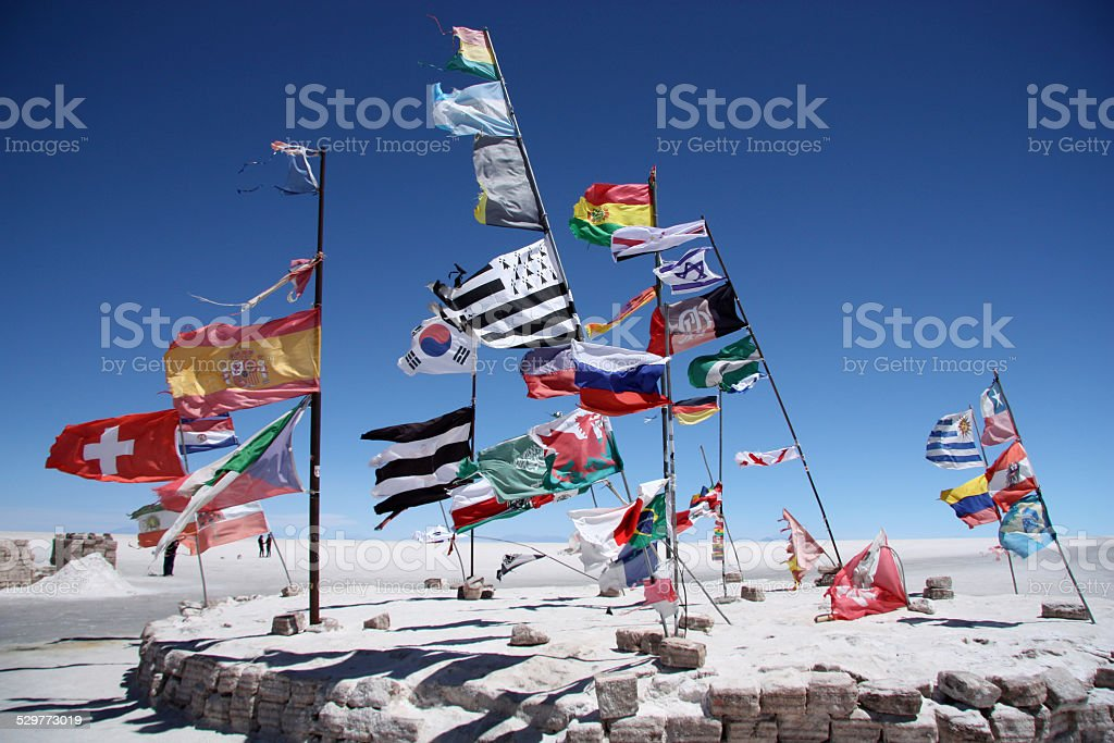 Flags of many countries in Salar de Uyuni stock photo