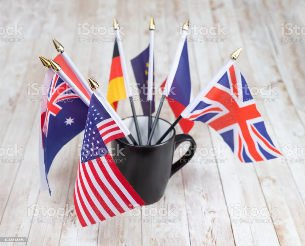 Flags of many large countries in a mug stock photo