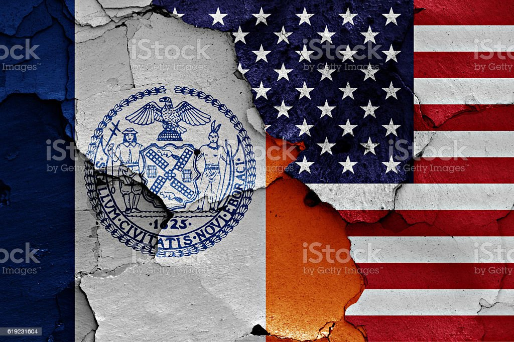 flags of New York and USA painted on cracked wall stock photo