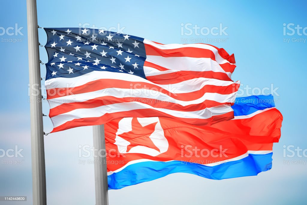Flags of North Korea and the USA stock photo
