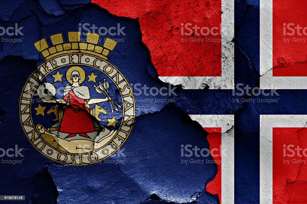 flags of Oslo and Norway painted on cracked wall stock photo