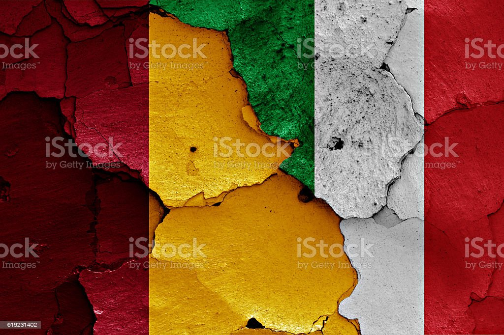 flags of Rome and Italy painted on cracked wall stock photo