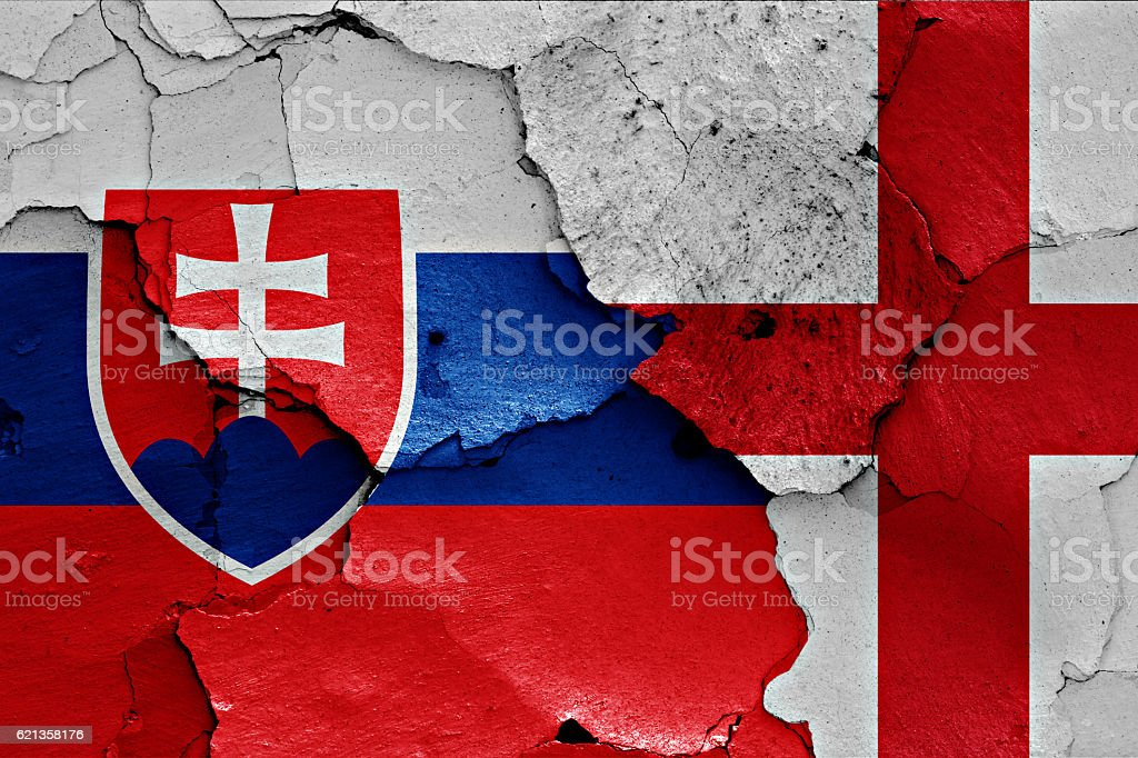 flags of Slovakia and England painted on cracked wall stock photo