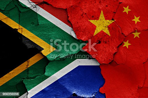 istock flags of South Africa and China painted on cracked wall 956356556