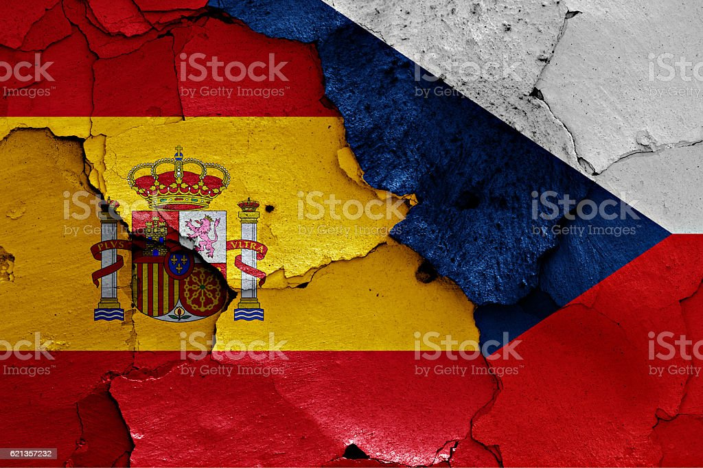 flags of Spain and Czech Republic painted on cracked wall stock photo