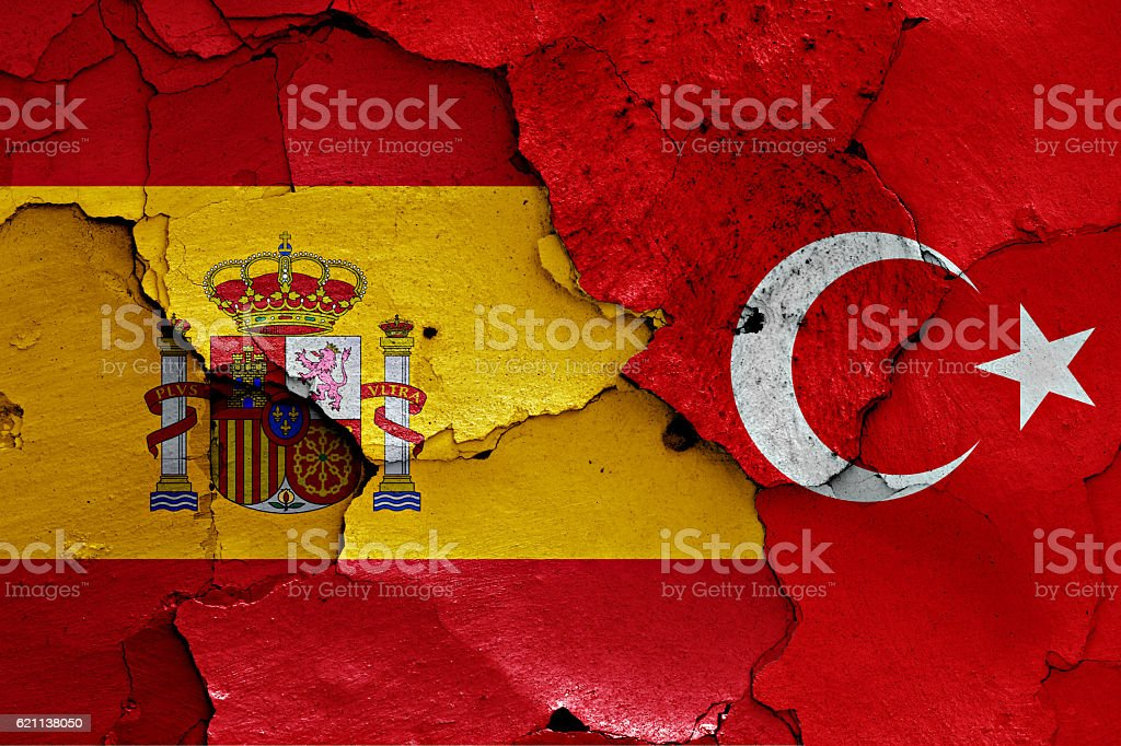 flags of Spain and Turkey painted on cracked wall stock photo