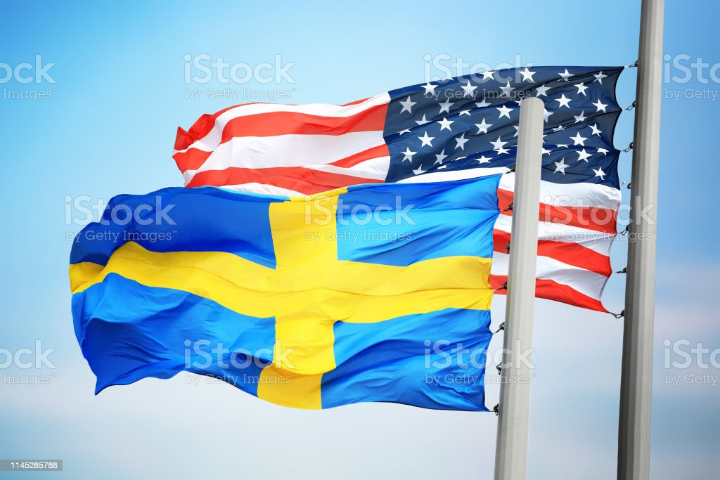 Flags of Sweden and the USA stock photo