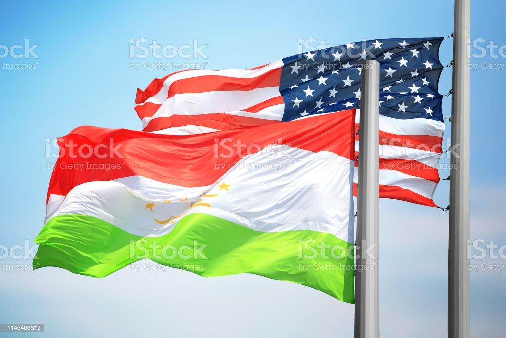 Flags of Tajikistan and the USA stock photo