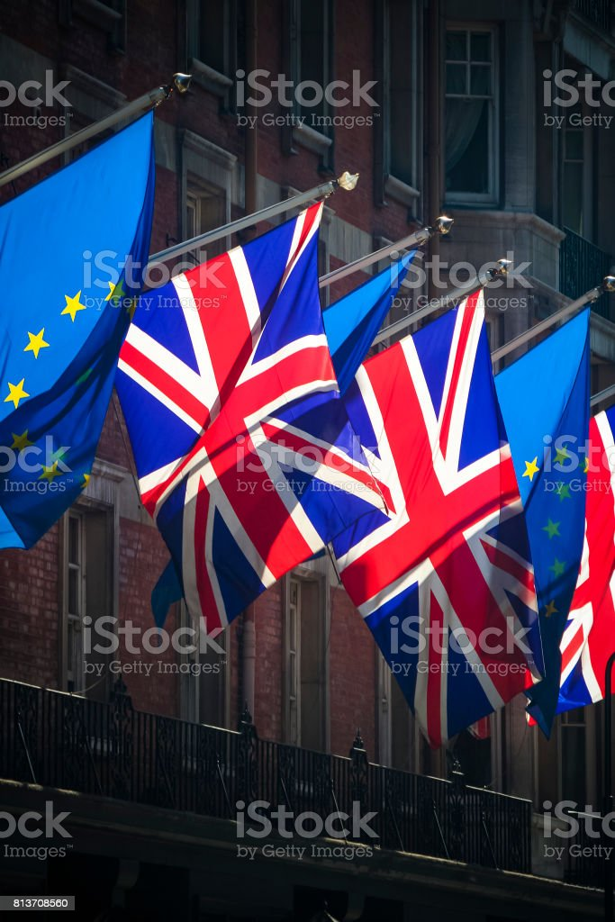 Flags of the European Union and United Kingdom flying next to each other stock photo