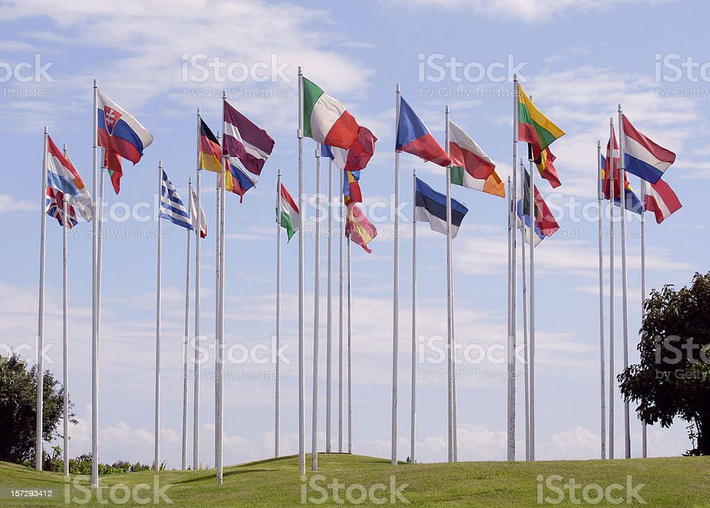 Flags of the European Union, in a circle, on tall flagpoles  stock photo