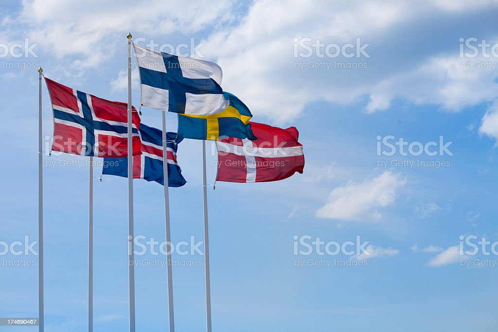 Flags of the Nordic Countries flying together in the wind stock photo