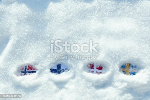 istock Flags of the Scandinavian countries in the snow. 1084974276