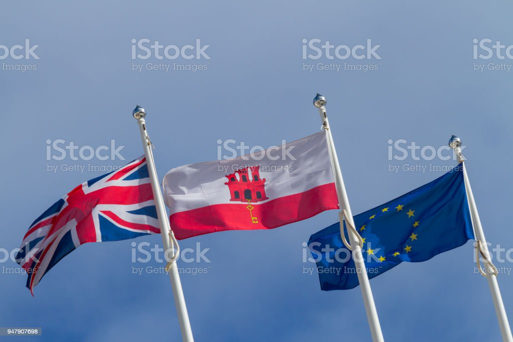 Flags of the United Kingdom, Gibraltar and Europe. stock photo