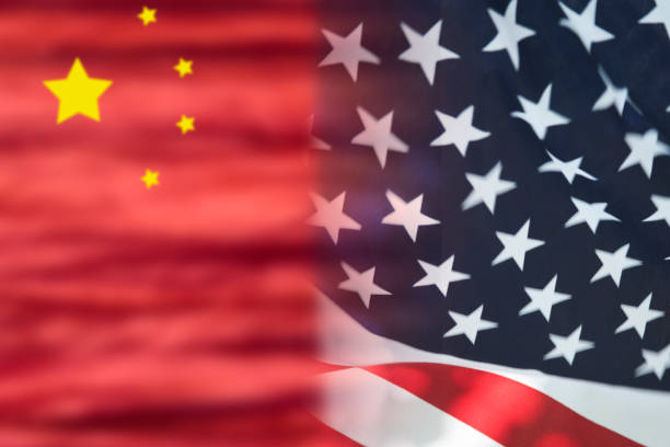 Flags of the United States of America and China.  Trade agreements and conflicts.  China origin of Coronavirus. Flags of the United States of America and China side by side, with blur where they join.  Agree or disagree.  Capitalism or communism. covid stock pictures, royalty-free photos & images
