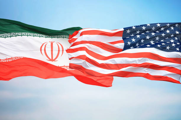 Flags of the USA and Iran Flags of the USA and Iran against the background of the blue sky iran stock pictures, royalty-free photos & images