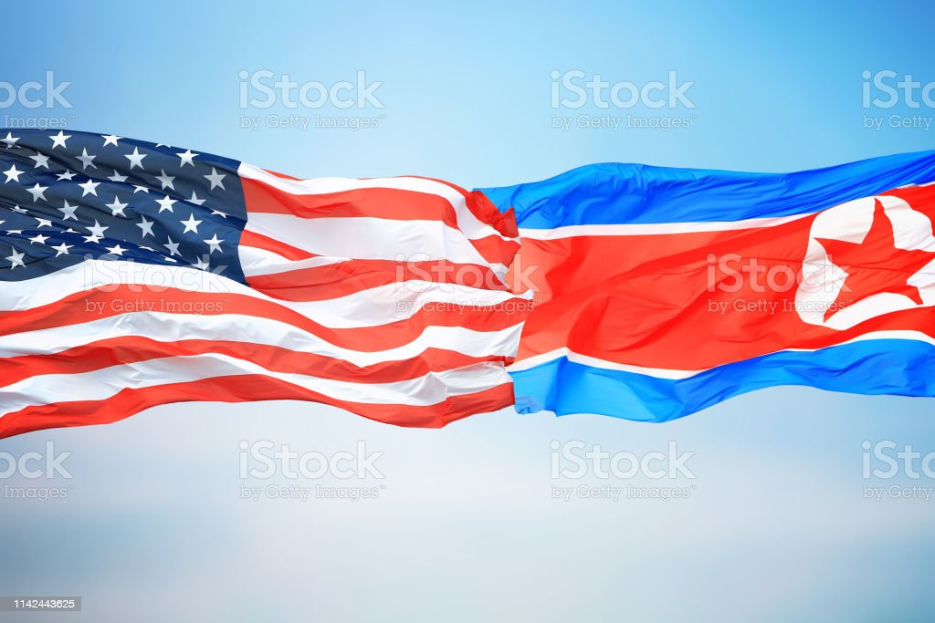 Flags of the USA and North Korea stock photo