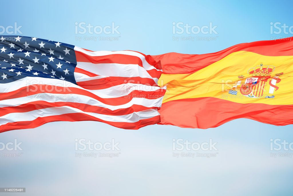 Flags of the USA and Spain stock photo