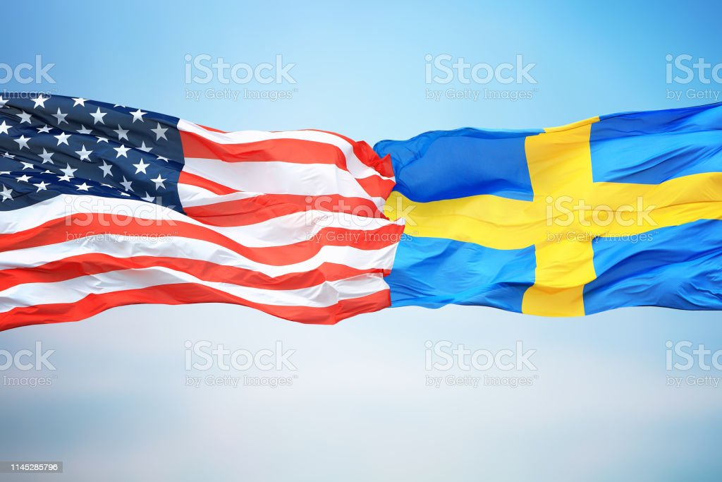 Flags of the USA and Sweden stock photo