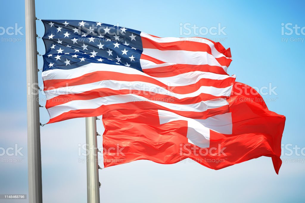 Flags of the USA and Switzerland stock photo