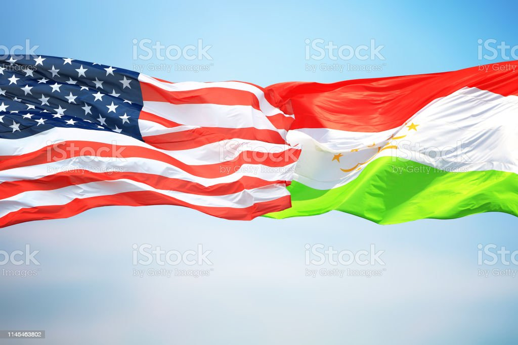 Flags of the USA and Tajikistan stock photo