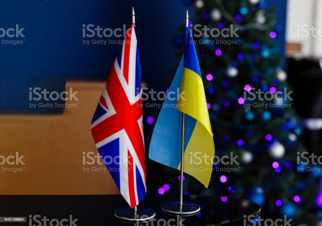 Flags of United Kingdom of GreatBritain and Ukraine stock photo